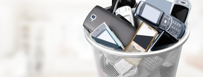 old electronics in a trash can