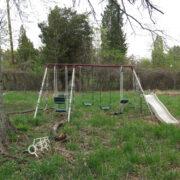 old swing set in backyard